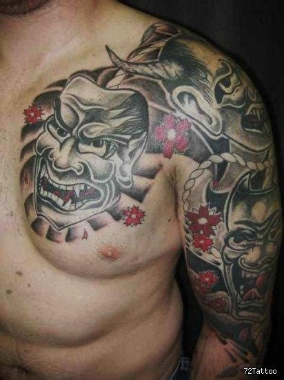 Tribal Tattoo On Back And Shoulder