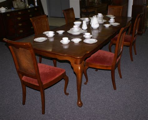 solid cherry dining room table and back chairs