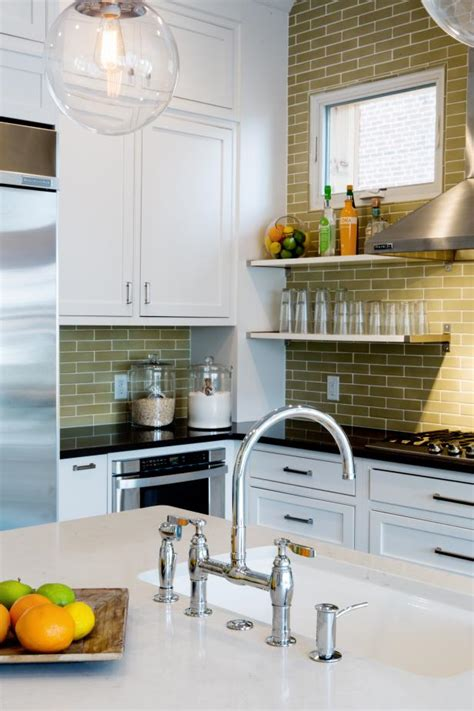 transitional white kitchen  neutral subway tile wall