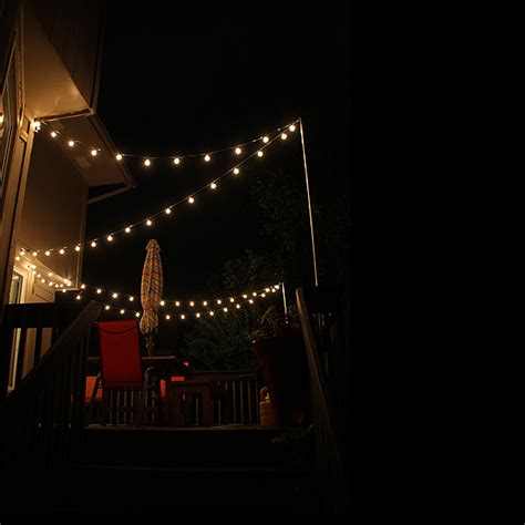 string lights over patio thrifty thursday how to hang string lights over the deck