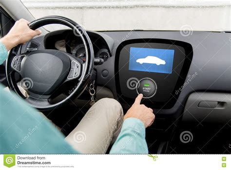Close Up Of Man In Car With Starter On Computer Stock