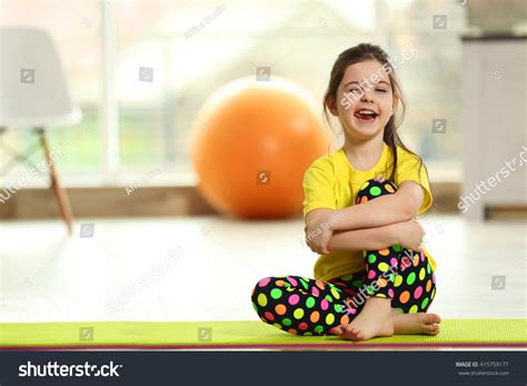 Sitting On The Mat - sitting on a mat indoor stock photo
