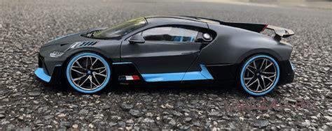 The silver/blue car has been specced to match the. BUGATTI Divo 2018 Matt-Grey/Light Blue