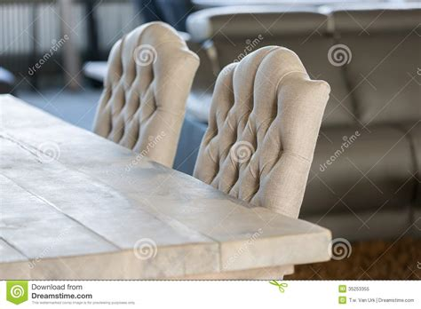 chaise de luxe luxury white chairs and wooden table with royalty free