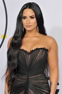 Demi Lovato Wavy Black Side Part Hairstyle | Steal Her Style