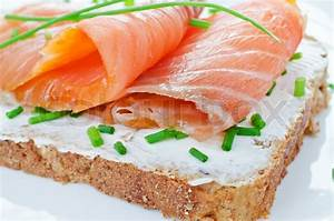 Smoked salmon sandwich with cream cheese and chives close ...