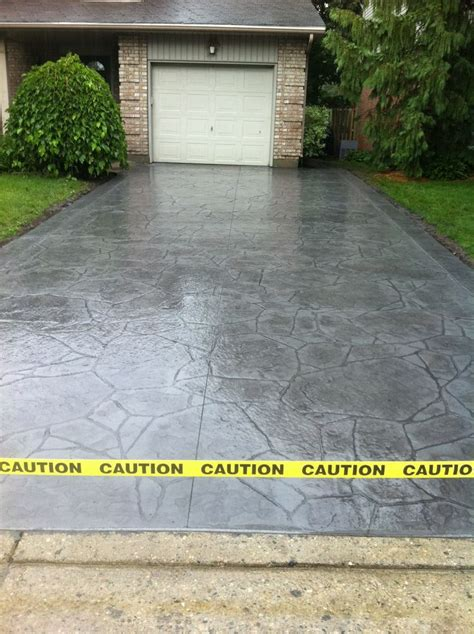 cost of paving driveway ontario arizona flagstone sted concrete driveway with rough cut border in london ontario driveway