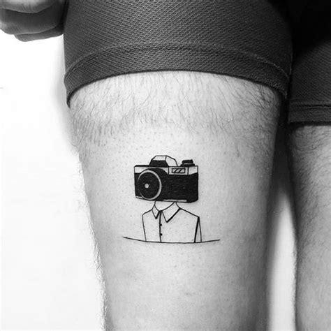 minimalist tattoo  camera  leg tattoo