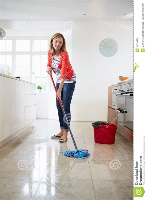 moping floor woman mopping kitchen floor stock image image 34153995