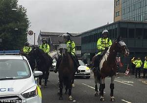 Masked protesters clash with police in Manchester ...