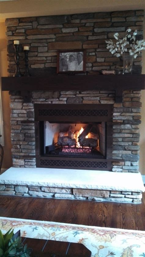 aspen southern  boral cultured stone  wood mantel
