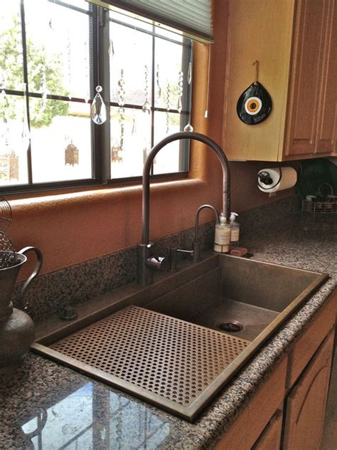 sink on top of counter sinks that sit on top of counter sink on granite home