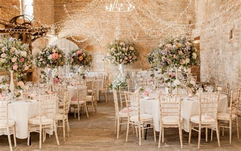 almonry barn wedding with pink colour scheme