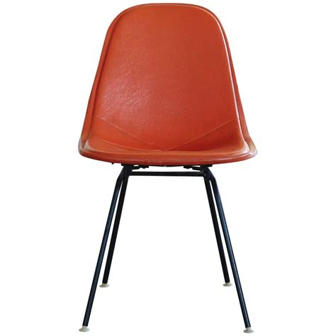 original eames dkx 1 side chair in orange leather for