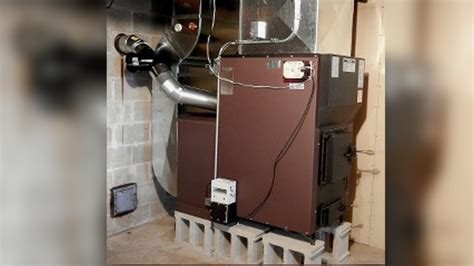 wood burning furnace meets epa standards proud green home