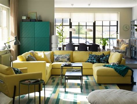 Large U-shaped Yellow Sofa In The Centre Of An Open Plan