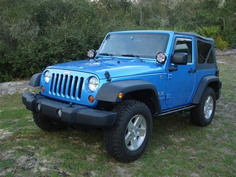 light blue jeep wrangler 2 door new lights and rails
