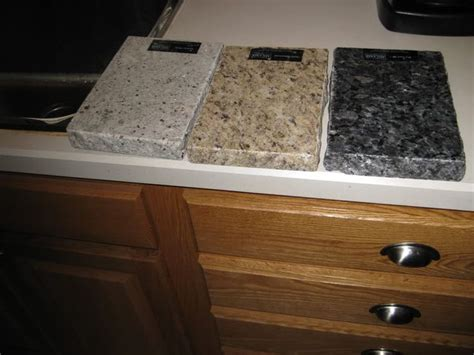 what color countertops go with oak cabinets golden oak kitchen cabinets with black countertops
