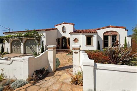 spanish style house with fence wall exterior paint colors