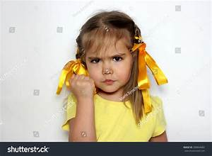 Angry Little Girl Yellow Bows Yellow Imagen De Archivo ...