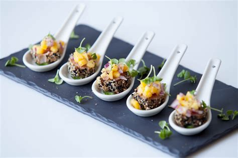 canape food ideas seared sesame tuna on cucumber topped with mango and