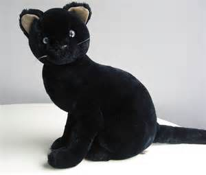 vintage black cat stuffed animal plush with bright blue