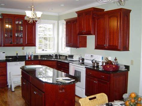 kitchen color ideas with cherry cabinets cherry cabinets and rounded oval shaped island kitchen 9191