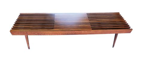 Measuring 19.75 w x 42 l, the clear, tempered glass tabletop strikes a rectangular silhouette, while beveled edges and rounded corners offer depth and dimension. Mid Century Modern Danish Expandable Slat Bench wood Coffee Table   Mary Kay's Furniture