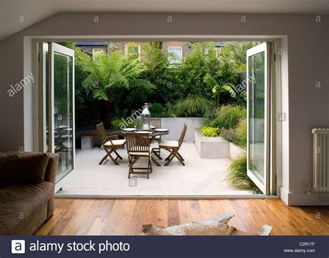 Living Room With Bi Fold Doors Opening On To Patio With