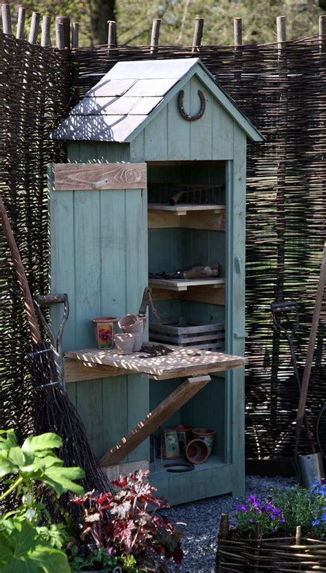 cute potting shed small  serves  purpose garden