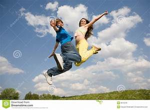 Happy Teens - Jumping Under Blue Sky. Soft Focus. Royalty ...