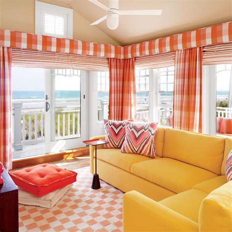 orange living room 20 ways to decorate with orange and yellow coastal living