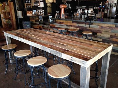 kitchen bar table against wall reclaimed wood bar restaurant counter community rustic