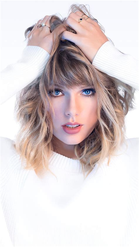 Brown short coated dog with blue eyes · download. Taylor Swift Blue Eyes White Background 4K Ultra HD Mobile Wallpaper