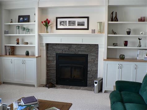 fireplace mantle and surround with cabinets shelves