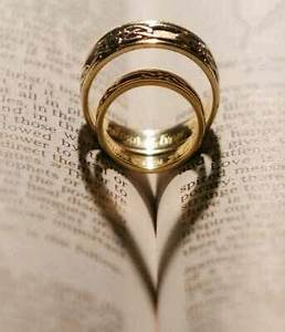 heart shaped wedding rings on bible wedding party ideas With wedding rings bible