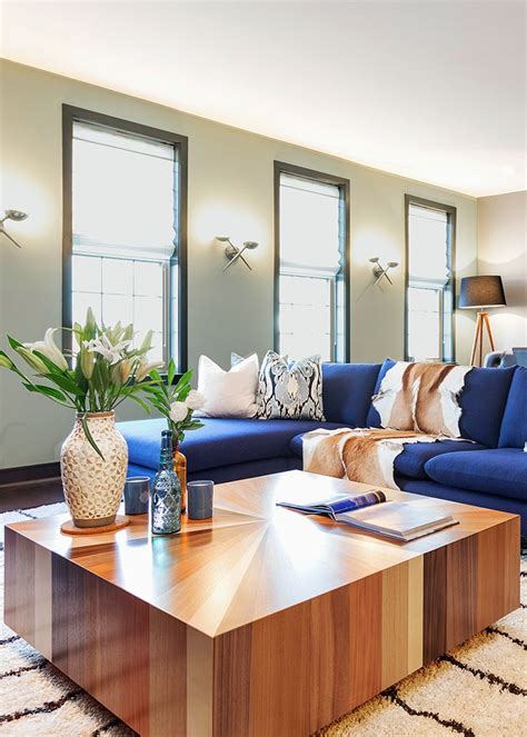 In this mid century modern living room a blue sectional