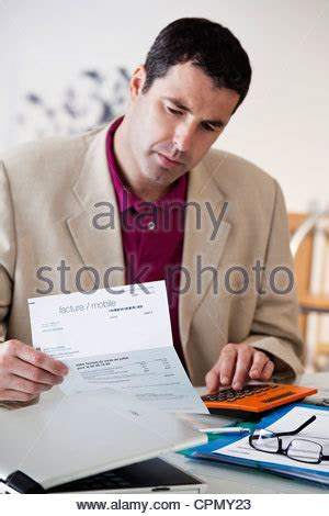 Man Filling Out Forms Stock Photo, Royalty Free Image