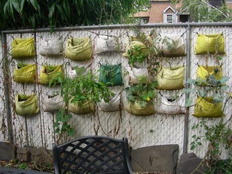 Recycled Plastic Planter Bags Hanging On The Wire Fence