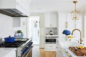Transitional Painted White Kitchen With Gold Accents