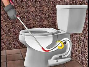 how to clear a toilet clog snake a toilet easily by