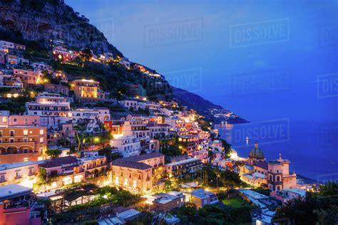 Cliff Side Buildings Illuminated At Night Positano