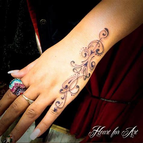 swirl tattoo  girl left hand tattoos pinterest