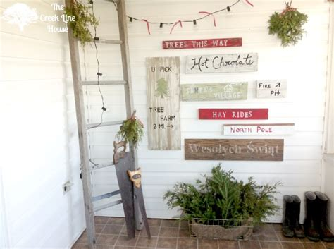 a tree farm inspired sign wall in the mudroom hometalk