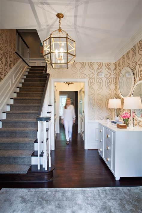 foyer  gold light fixture  whimsical wallpaper hgtv