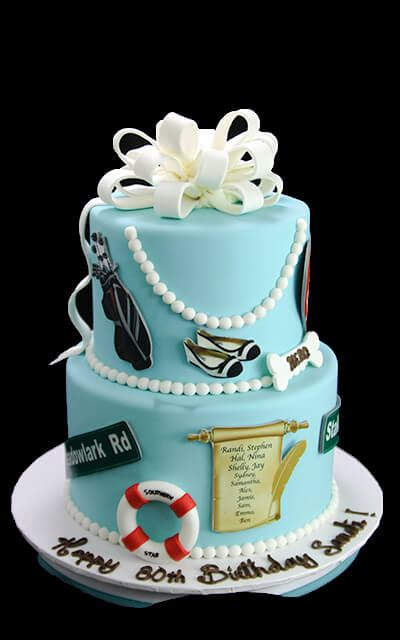 Birthday cakes are often layer cakes with frosting served with small lit candles on top representing the celebrant's age. 60th Birthday Cake - Butterfly Bake Shop in New York