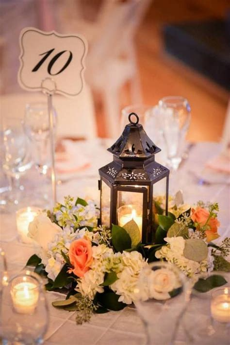 Lantern with floral halo centerpiece by Best Day Floral