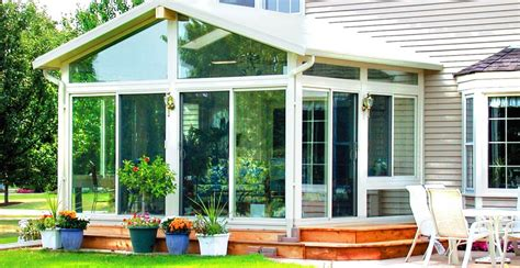 sunroom glass enclosure with wooden deck