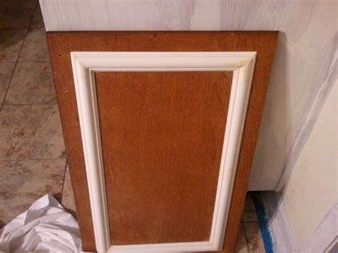 adding trim to plain cabinets add trim and a new coat of paint to old cabinets for a