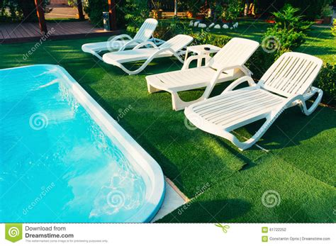 chaise lounge chairs poolside stock photo image 61722252